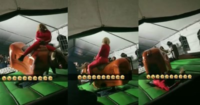 Video of a woman riding a mechanical bull until her wig comes flying off.