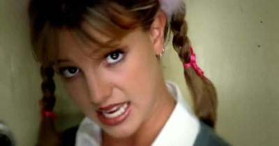 Meme of Britney Spears in the music video for 'Baby One More Time' where she's saying that her unrealistic life expectations are killing her