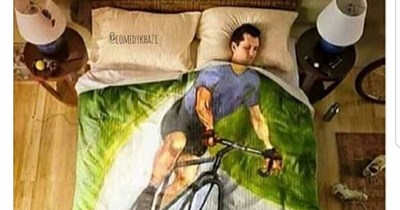 """Caption that reads, """"When I tell someone I'm on my way"""" above a pic of a guy sleeping under a comforter with an image of a guy riding a bicycle on it"""