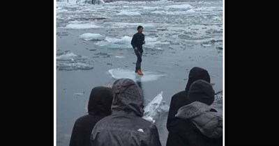 Funny video of a tourist getting stuck on a small iceberg and then beginning to float away