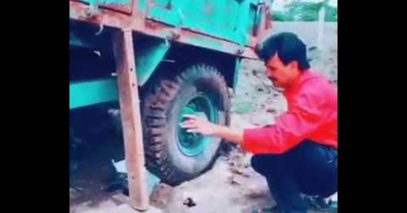 Dude Uses Dump Truck to Get Itself Out of Pothole