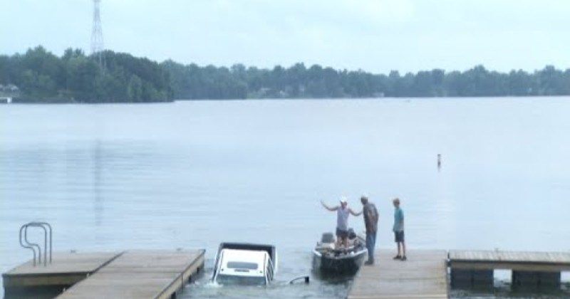 Truck Rolls Down Boat Launch Into Lake During News Broadcast