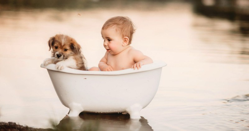 Photographer Celebrates The Joy Of Kids Cuddling With Similarly-Sized Pets