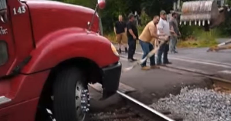 Semi Gets Stuck On Tracks With Train Coming, Saved By Back